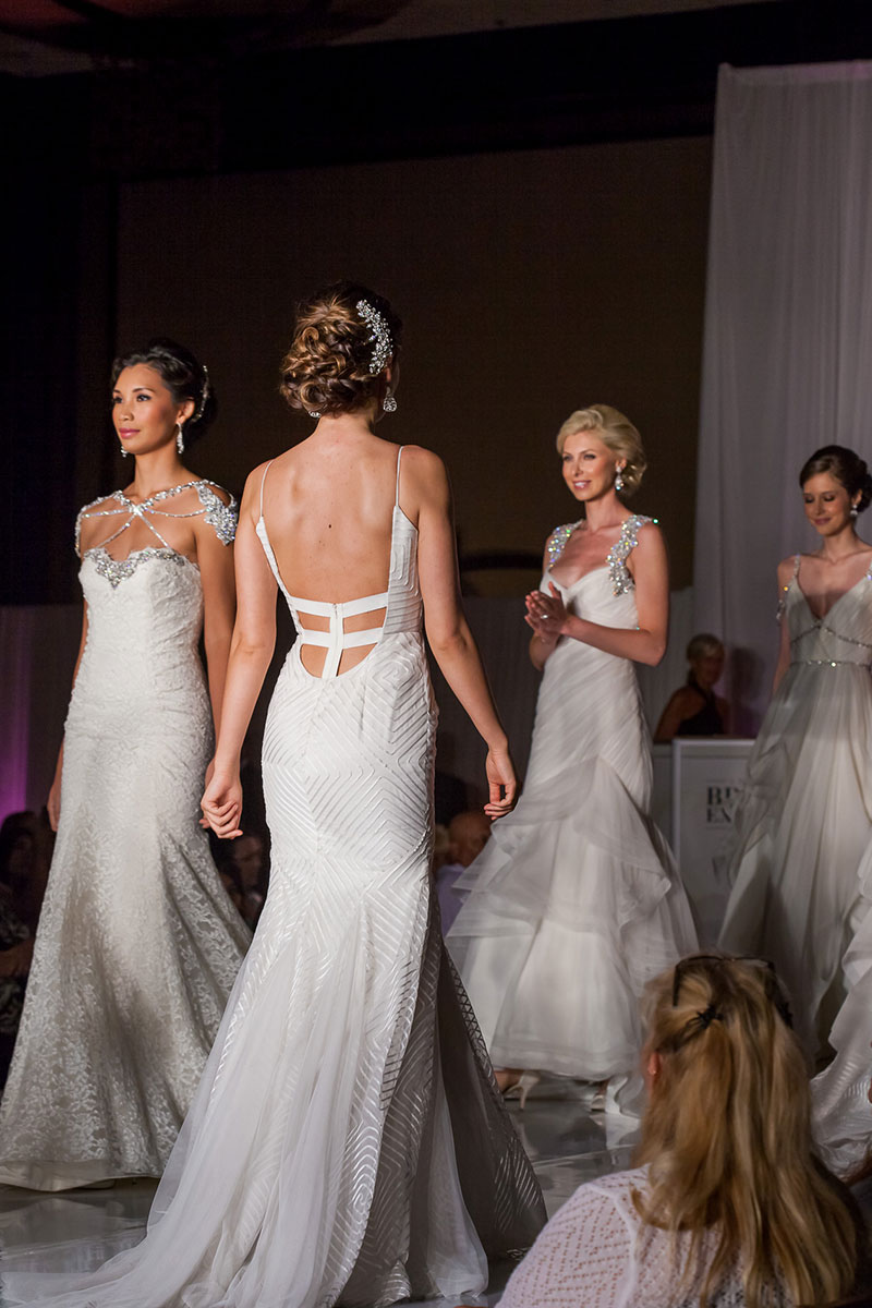 Models in couture bridal gowns at Bridal Expo Chicago runway show.