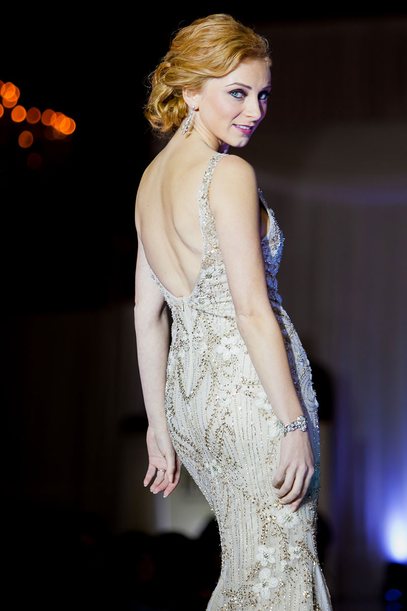 Model with red hair in bridal gown at Bridal Expo Chicago runway show.